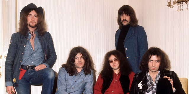 Roger Glover, Ian Gillan, Ian Paice, Jon Lord (standing at back) and Ritchie Blackmore.