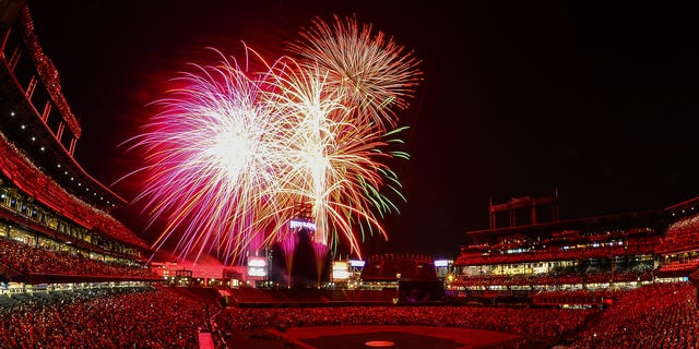 A general overhead view of Coors Field as fans fill the outfield during a fireworks show after a game between the Colorado Rockies and the San Francisco Giants at Coors Field on July 4, 2018 in Denver, Colorado.