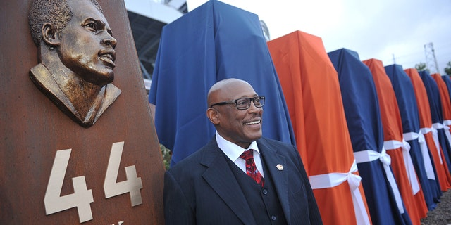 Pro Football Hall of Fame running back Floyd Little unveiled the sculpture at the Denver Broncos Ring of Fame Plaza in Sports Authority Field at Mile High. Denver, Colorado. September 27, 2013. The Plaza feature pillars honoring each of the 24 players in the Broncos Ring of Fame. (Photo by Hyoung Chang/The Denver Post via Getty Images)