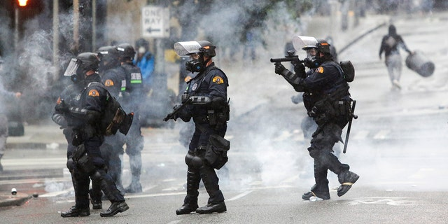 Police use tear gas after protests against the death of George Floyd, a black man who died May 25 in the custody of Minneapolis Police, turned destructive in Seattle, Washington on May 30, 2020.