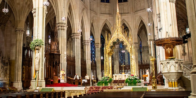 Cardinal Timothy Dolan celebrates Easter Mass amid the Coronavirus pandemic in the near-empty St. Patrick's Cathedral on April 12, 2020 in New York City. (Photo by Kena Betancur / AFP) (Photo by KENA BETANCUR/AFP via Getty Images)