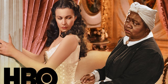 Vivien Leigh as Scarlett O'Hara has her corset tightened by Hattie McDaniel as Mammy in 'Gone with the Wind.' (Photo by Silver Screen Collection/Getty Images)