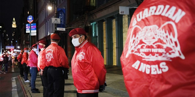 Members of the Guardian Angels, a volunteer organization of unarmed citizens which began in the late 1970's, stand guard near looted stores during a night of protests and vandalism over the death of George Floyd on June 1, 2020, in New York City. (Spencer Platt/Getty Images)