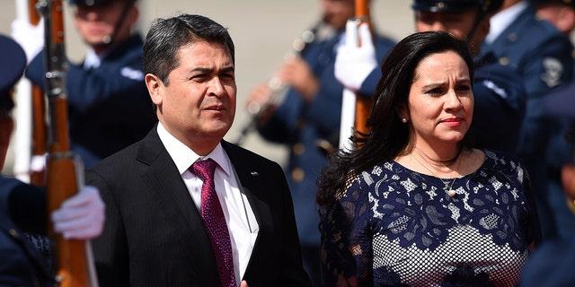 Honduran President Juan Orlando Hernandez (L) and his wife Ana Garcia have both tested for coronavirus. (Photo by Diana Sanchez / AFP) (Photo credit should read DIANA SANCHEZ/AFP via Getty Images)