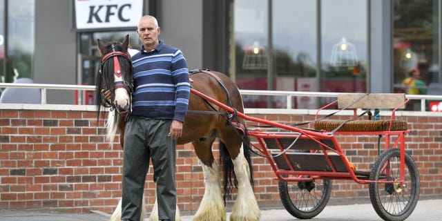 Ian Bell says that a manager of the KFC came outside after Bell pulled into the drive-thru with his horse-drawn carriage, Southwest News Service (SWNS) reports.
