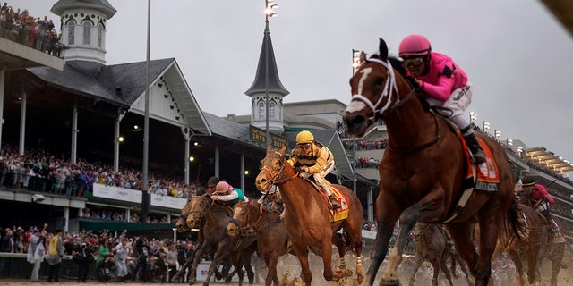 Luis Saez rides Maximum Security, right, across the finish line first against Flavien Prat on Country House during the 145th running of the Kentucky Derby at Churchill Downs in Louisville, Ky., May 4, 2019. (Associated Press)<br> ​​​​