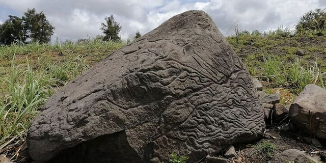 The carved rock is on private land in Colima, Mexico.
