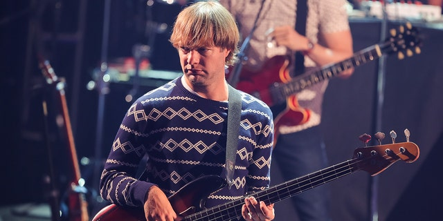 Musician Mickey Madden performs onstage during the iHeartRadio Album Release Party with Maroon 5 for their album 'V' at iHeartRadio Theater on August 26, 2014, in Burbank, Calif. (Photo by Chelsea Lauren/WireImage)