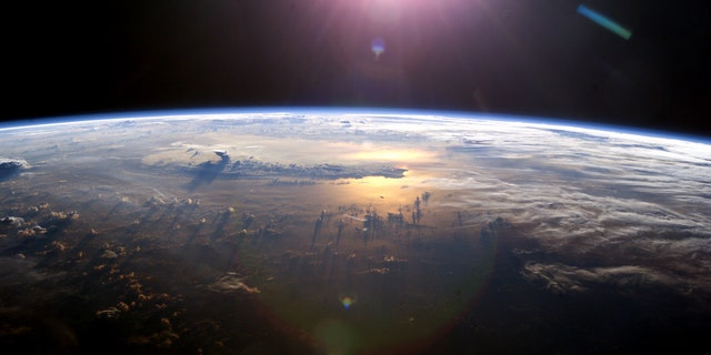 A view of Earth's horizon as the sun sets over the Pacific Ocean. This image was taken by an Expedition 7 crew member onboard the International Space Station - file photo.