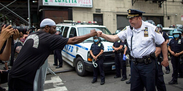 NYPD Deputy Police Chief McCarthy greets protesters as they take part in a solidarity march for George Floyd, Tuesday, June 2, 2020, in New York. Floyd, a black man died after being restrained by Minneapolis police officers on May 25.(AP Photo/Eduardo Munoz Alvarez)