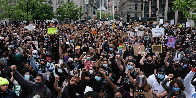 Protesters gather to protest the death of George Floyd at Foley Square, Tuesday, June 2, 2020, in New York. Floyd, a black man, died after being restrained by Minneapolis police officers on May 25.