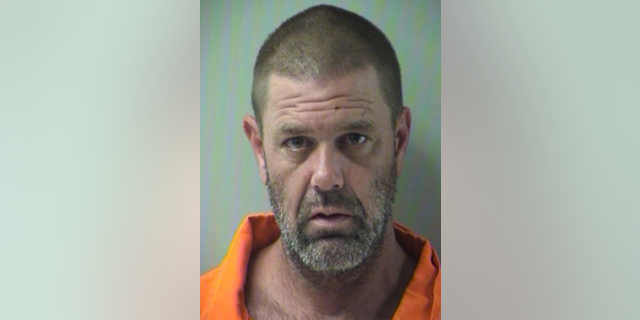 Mathew Ross Peters, 42,was arrested on Tuesday after allegedly shooting a cyclist in the head with a crossbow.
