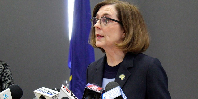 Oregon Gov. Kate Brown speaks at a news conference in Portland, Ore, March 16, 2020. The Oregon Supreme Court has upheld the governor's shutdown orders aimed at preventing the spread of the coronavirus. (Associated Press)