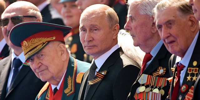Russian President Vladimir Putin, center, watches the Victory Day military parade marking the 75th anniversary of the Nazi defeat in Moscow, June 24, 2020. (Associated Press)