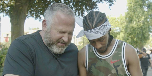 Pastor Brian Gibson, founder of the Peaceably Gather movement and His Church leader, prays with a Black Lives Matter protester near the CHOP zone in Seattle.