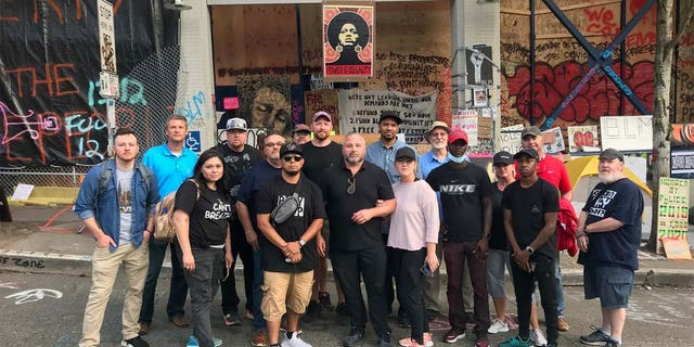 A group of evangelical pastors gather at Seattle's CHOP zone to pray and declare that they will defend houses of worship from any forms of attacks.