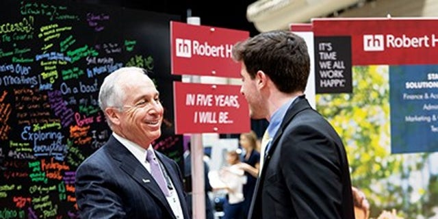 Paul McDonald, senior executive director at Robert Half, greeting a student at an Enactus event. He's been speaking with college grads throughout this time about the current environment and providing tips and tactics for what they should be considering as they enter the job market.