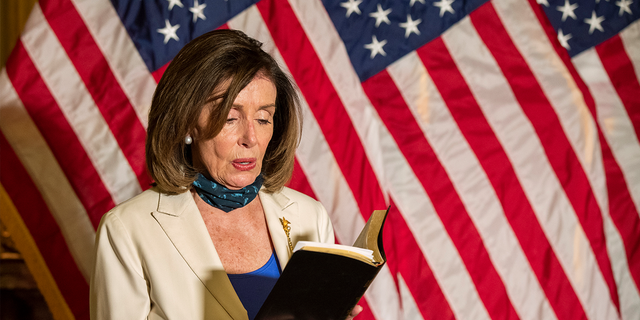 House Speaker Nancy Pelosi, D-Calif., reads from the Bible, as she reacts to President Trump during a news conference at the U.S. Capitol in Washington, June 2, 2020. (Associated Press)