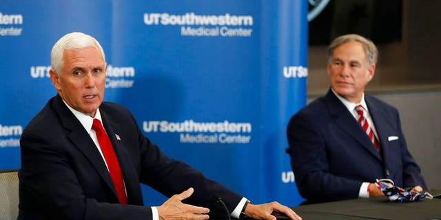 Vice President Mike Pence makes remarks as Texas Gov. Greg Abbott looks on during a news conference after Pence met with Abbott and members of his healthcare team regarding COVID-19. (AP Photo/Tony Gutierrez)