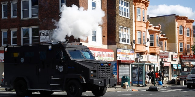 Police deploy tear gas to disperse a crowd during a protest Sunday, May 31, 2020, in Philadelphia over the death of George Floyd.