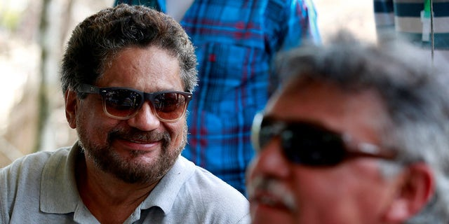Ivan Marque (L) and Jesus Santrich, members of the Revolutionary Armed Forces of Colombia (FARC), talk to the media during the congress at the camp where they will ratify a peace deal with the government, near El Diamante in Yari Plains, Colombia, September 21, 2016. REUTERS /John Vizcaino - S1BEUCPYDBAA