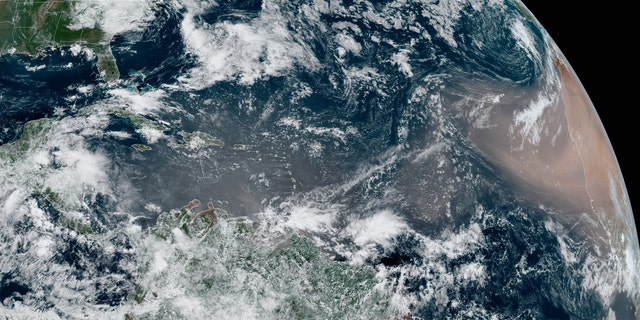 A dust cloud from the Sahara swirls west over the Atlantic Ocean on June 17.