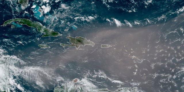 This satellite photo provided by the National Oceanic and Atmospheric Administration, NOAA, shows a could of dust coming from the Sahara desert arriving to the Caribbean Monday, June 22, 2020.