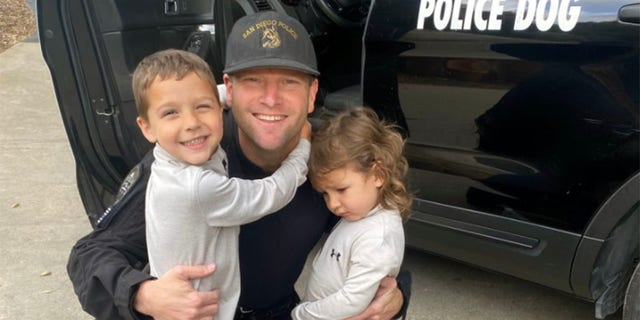 San Diego Police Department K9 Officer Jonathan Wiese with his own young son and daughter. (San Diego Police Department)聽