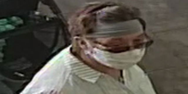 Photo of the unidentified woman who allegedly coughed on a baby at a Yogurtland in San Jose, Calif.