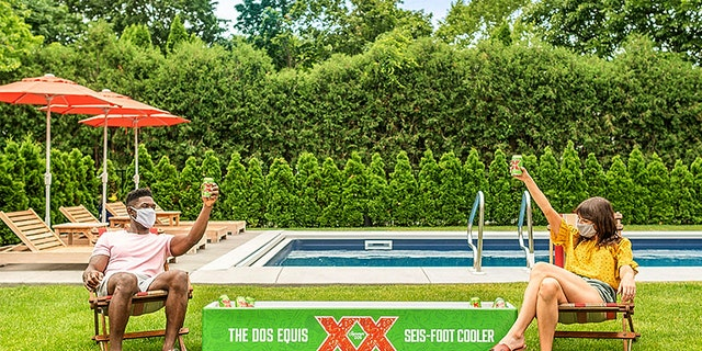 Dos Equis is giving away a select number of 6-foot coolers for socially distanced beer drinking this summer.