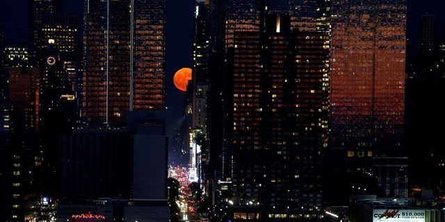 A full moon known as a strawberry moon rises over 42nd Street in New York, United States on June 28, 2018 - file photo.