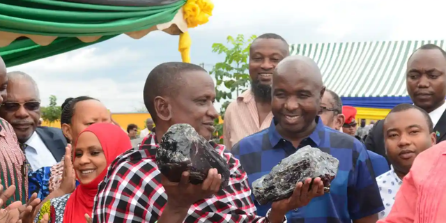 Saniniu Laizer poses with two rough Tanzanite stones back in June, said to be the largest ever found in the country.