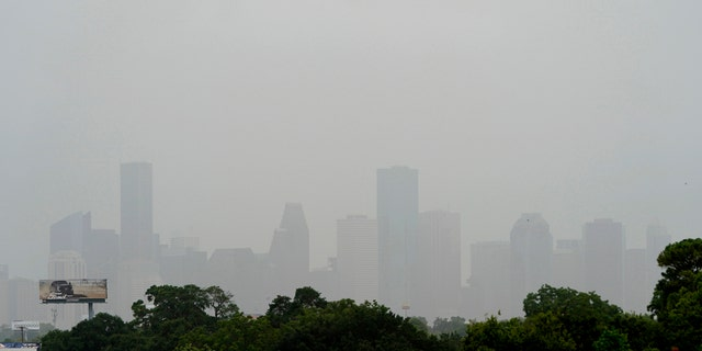 Downtown Houston is shown as a Saharan Dust cloud moves over parts of Texas, June 26, in Houston.