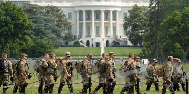 Uniformed military personnel walk in front of the White House ahead of a protest against racial inequality in the aftermath of the death in Minneapolis police custody of George Floyd, in Washington, U.S. June 6, 2020.