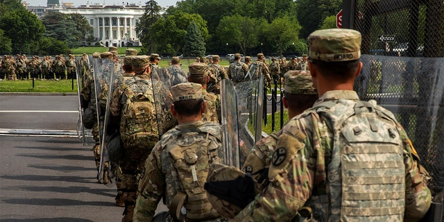 Uniformed military personnel walks into the secured White House area ahead of a protest against racial inequality in reaction to the death in Minneapolis police custody of George Floyd, in Washington, U.S., June 6, 2020.