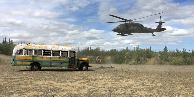 "An Alaska Army National Guard UH 60 Blackhawk helicopter hovers near ""Bus 142,"" made famous by the ""Into the Wild"" book and movie."