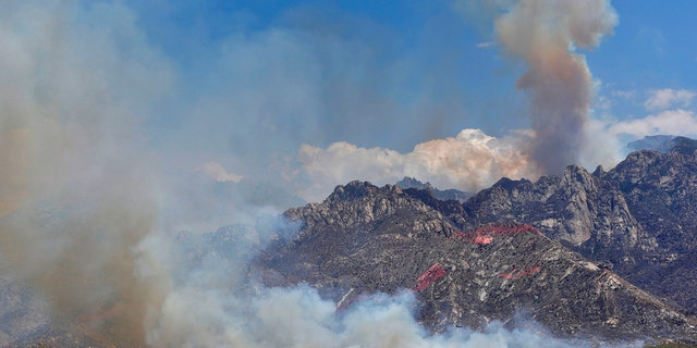 Wildfire air attack crews continue to battle the Bighorn Fire along the western side of the Santa Catalina Mountains, Friday, June 12, 2020, in Oro Valley, Ariz.