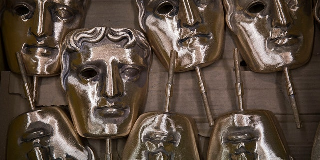 In this Tuesday, Jan. 31, 2020 file photo, bronze alloy masks lie in a foundry in West Drayton, Middlesex, ahead of the awards ceremony in February. (Associated Press)