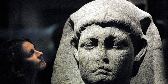 Sally-Ann Ashton admires one of the statues of Cleopatra at the launch of an exhibition at The British Museum in London 10 April 2001 - file photo.