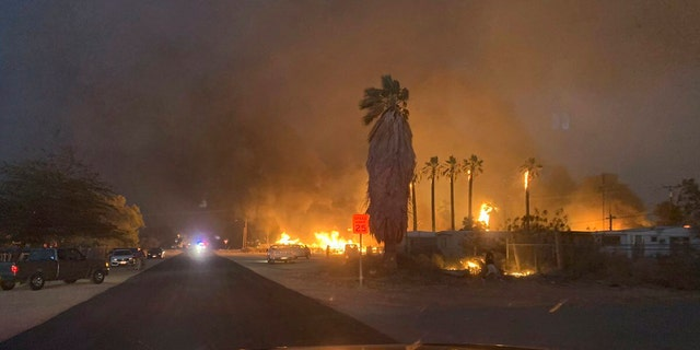 A wind-driven wildfire has destroyed about 40 homes and forced evacuations as it tore through the rural town of Niland in the Southern California desert near the Salton Sea.