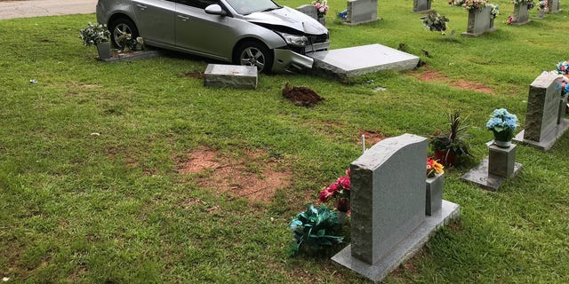 Police say the car plowed into the grave site after it was stolen Saturday. (Carrollton Police Department)