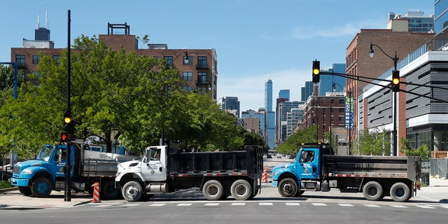Department of Water Management trucks are used to block the northbound lanes of South Wabash Avenue, Sunday, May 31, 2020, as part of a security perimeter around downtown Chicago.