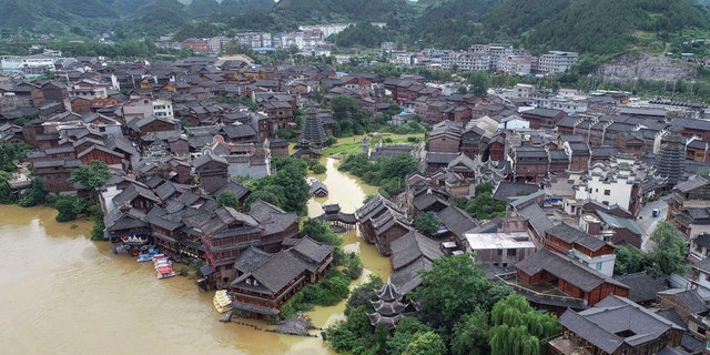 An aerial view shows the ancient town of Xiasi during flooding in Kaili city in southwest China's Guizhou province, June 23.