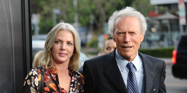 Director Clint Eastwood and girlfriend Christina Sandera attend a screening of