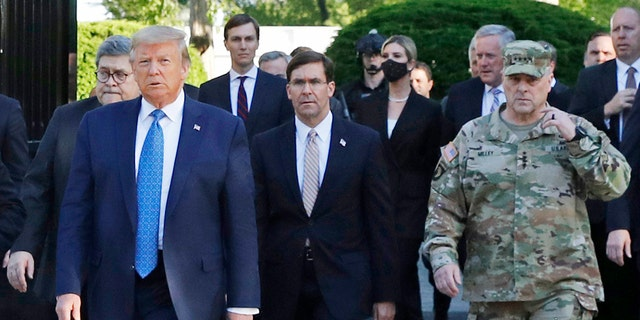 FILE - In this June 1, 2020 file photo, President Donald Trump departs the White House to visit outside St. John's Church, in Washington. Part of the church was set on fire during protests on Sunday night. Walking behind Trump from left are, Attorney General William Barr, Secretary of Defense Mark Esper and Gen. Mark Milley, chairman of the Joint Chiefs of Staff. Milley says his presence Òcreated a perception of the military involved in domestic politics.Ó He called it Òa mistakeÓ that he has learned from. (AP Photo/Patrick Semansky)