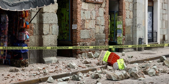 Security tape alert people of a building damaged by an earthquake in Oaxaca, Mexico,Tuesday, June 23, 2020.