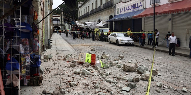 Security tape alert people of a building damaged by an earthquake in Oaxaca, Mexico, Tuesday, June 23, 2020.