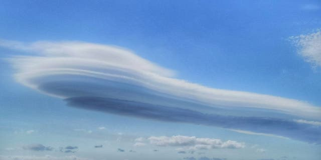 """The images were taken by Stuart Woolger who noticed a """"strange cloud formation"""" while cycling between Exmouth and Lympstone in Devon on June 22. (Credit: SWNS)"""