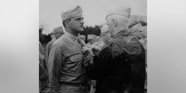Lt. Frank Tachovsky is awarded the Silver Star from Adm. Chester Nimitz.