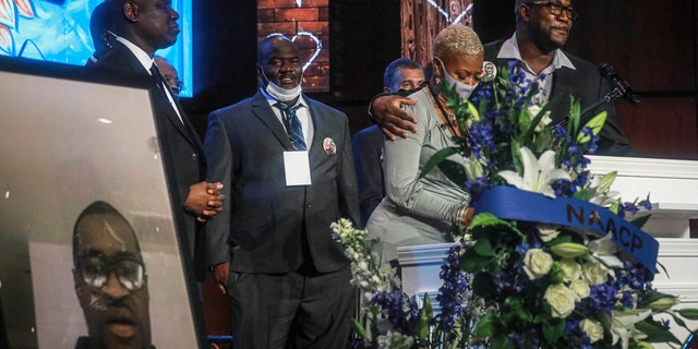 George Floyd's brother Philonise Floyd, far right, and cousin Shareeduh Tate, second from right, share their memories of Floyd at a memorial service at North Central University, on June 4, in Minneapolis. (AP Photo/Bebeto Matthews)